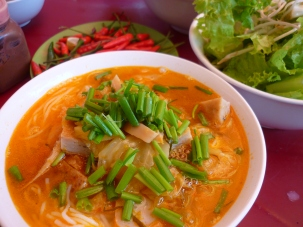 more delicious food; Bun Cha Ca. Noodle soup made with pumpkin, pineapple and fish patties.