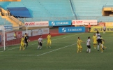 Long An (in white) attack the T&T goal