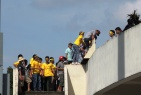 SLNA fans climb in to the stadium before its open