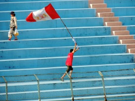 A Ninh Binh fan celebrates the opening goal