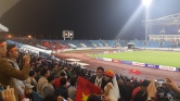 Wedding photos are a big deal in Vietnam...never seen them at football stadium before though!