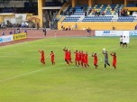Hai Phong players salute their impressive travelling fans before kick-off