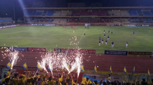 Fan and players celebrate T&T's late win